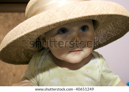 baby in a straw hat