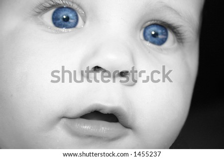Baby in black and white with blue eyes