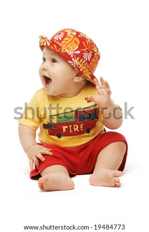 stock-photo-baby-in-bright-cloths-sitting-his-hand-to-his-ear-mouth-open-looking-puzzled-19484773.jpg
