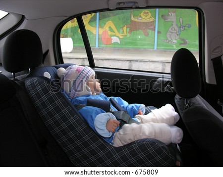 baby in car with dreams in window #675809