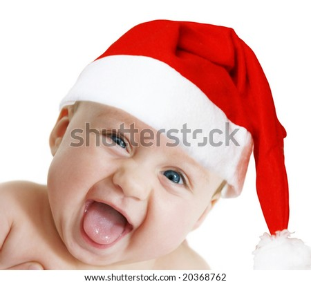 baby in Christmas bonnet looks at camera, on white background
