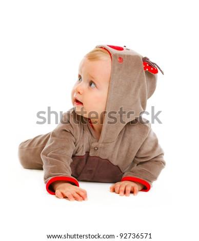 Baby in costume of Santa Claus's reindeer looking in corner