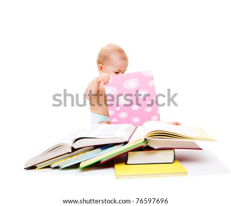 Baby in diaper looking attentively into the book