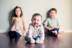 baby in front of siblings