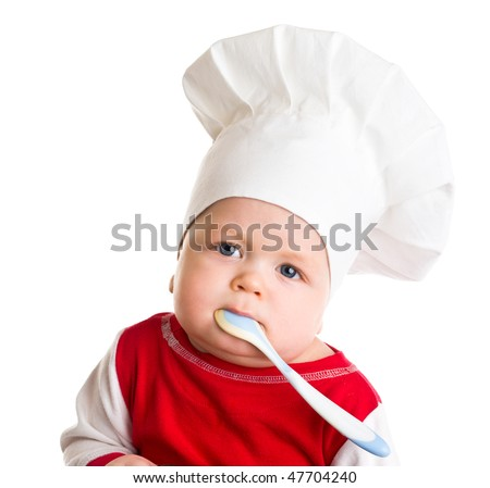 Baby in the cook costume in the white hat