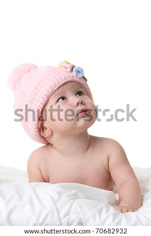 Baby in winter hat looking up