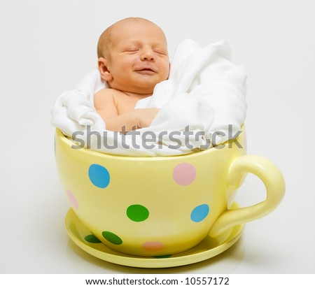 stock-photo-baby-in-yellow-cup-10557172.jpg