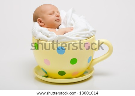 Baby in yellow cup