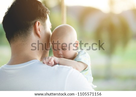 baby is being carried by father. father always carries him because he loves his son #1105571156