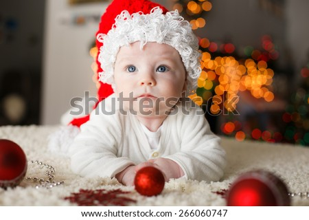 Baby is playing with christmas ornaments for the first time