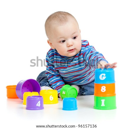baby is playing with educational toys over white background