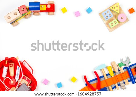 Baby kids toys background. Wooden educational toys, train, rainbow, airplane, blocks, construction tools and set of toy medical devices on white background