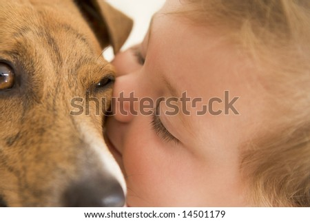 Baby kissing dog