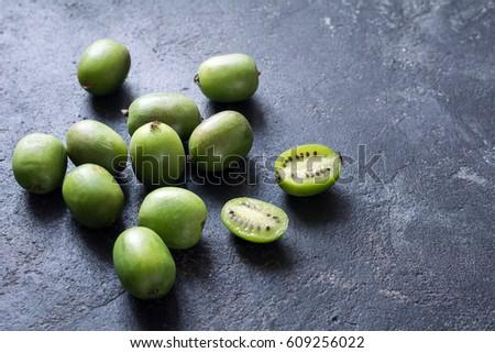 Baby kiwi or mini kiwi fruits on stone background. Closeup view Photo stock ©