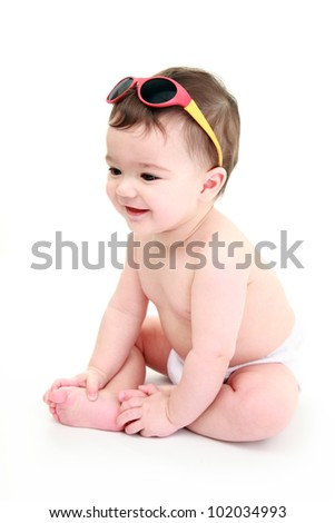 Baby laughing wearing sunglasses #102034993