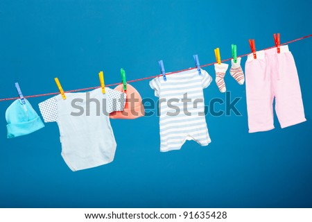 Baby laundry hanging on the rope