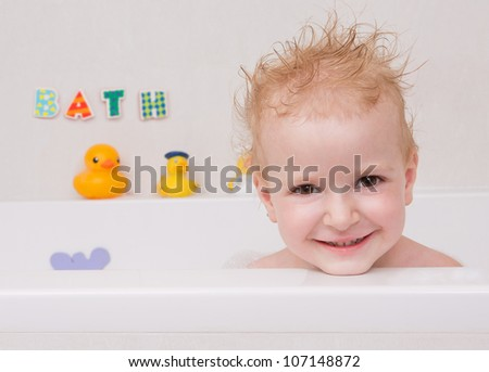 Baby looking out of the bath