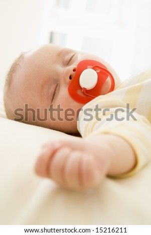 Baby lying indoors sleeping