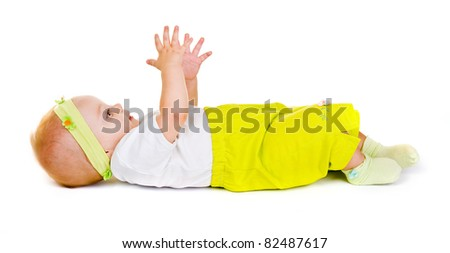 baby lying on a back.young child on a white background.