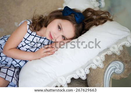 Baby lying on a sofa on a pillow