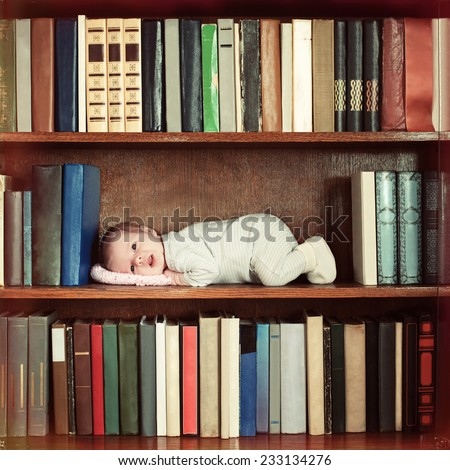 baby lying on book shelf in bookcase