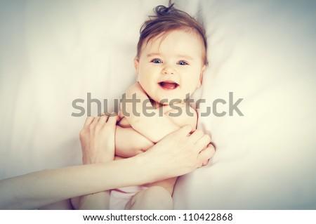 baby Massage - stock photo