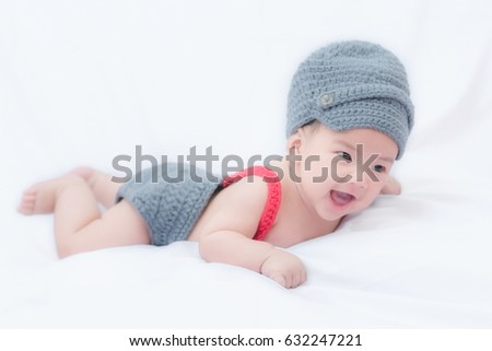 5f404ecf6 3 month old baby lying down wearing homemade knitted clothes ...