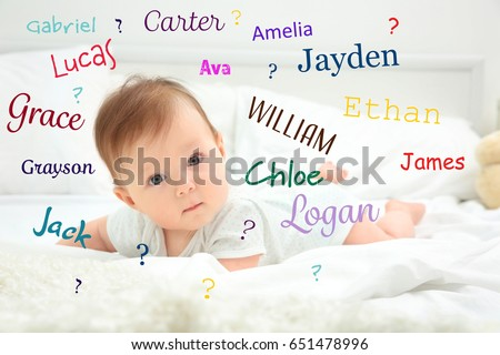 Baby names concept. Cute little child lying on bed at home ストックフォト ©