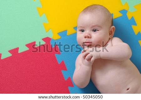 baby on a puzzle background