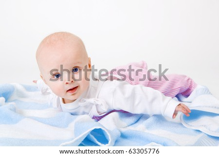 baby on a towel in the studio on a white background