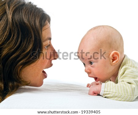 baby on stomach and mother looking at each other