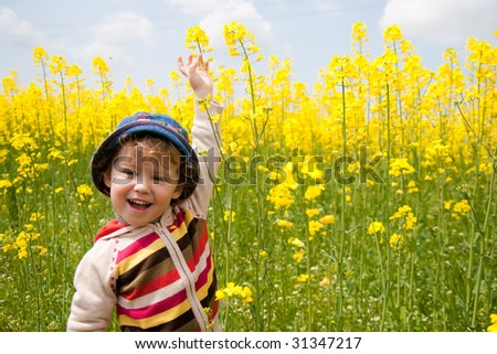 baby on the rapeseed field