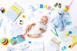 Baby on white background with clothing, toiletries, toys and health care accessories. Wish list or shopping overview for pregnancy and baby shower. View from above. Child feeding changing and bathing