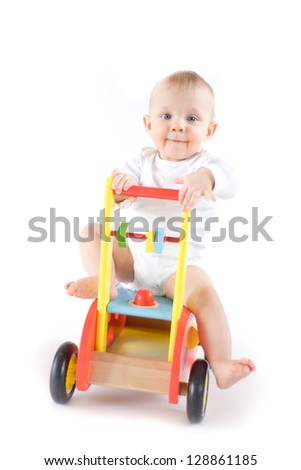 Baby on wooden car