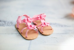 Baby pink sandals in the interior
