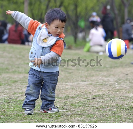 baby playing football