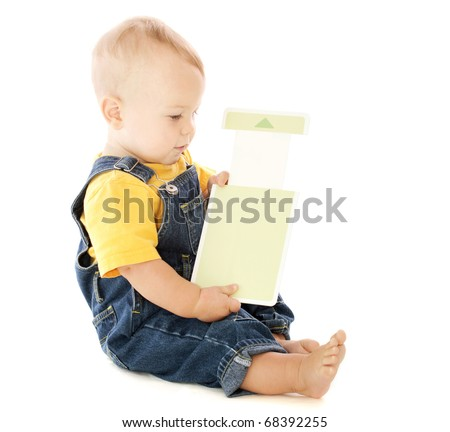 Baby playing with a flashcard, learning, isolated on white