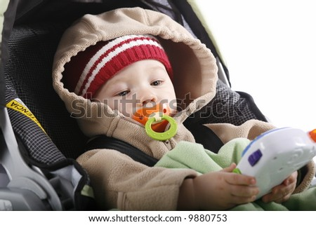 Baby playing with toy in car seat