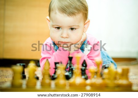baby plays chess