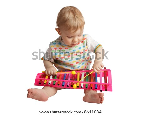 baby plays with a musical toy