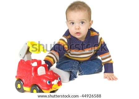 Baby plays with fire truck toy