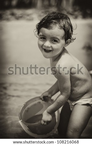 Baby relaxing and joking at the Beach, Italy - stock photo
