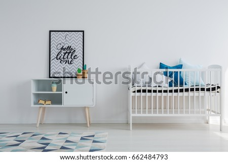 Baby room in scandi apartment with vintage furniture