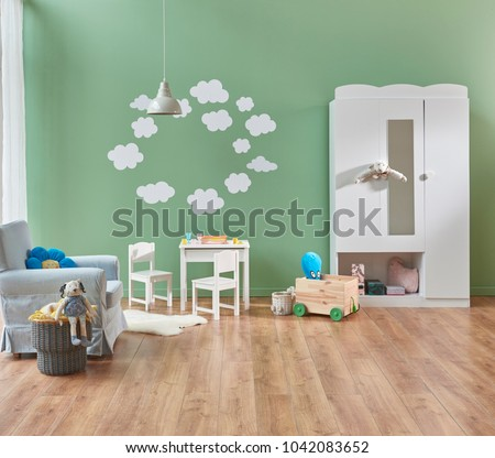 baby room modern and new style. Green wall and background decoration white detail and sofa. Modern cupboard decoration. #1042083652