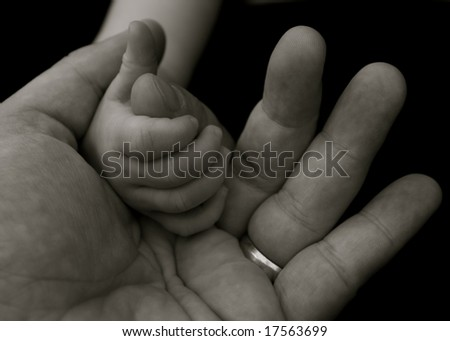 Baby's grip on a fathers hand