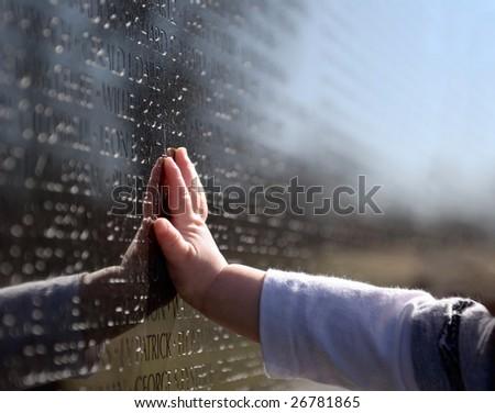 Baby's Hand on Vietnam Memorial