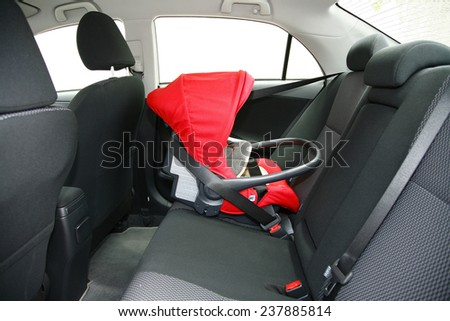 baby safety seat placing it in the car