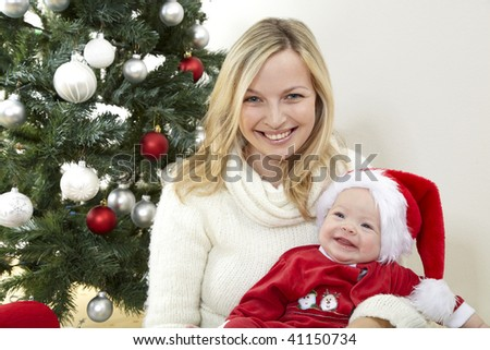 baby santa claus with young mother Stock foto ©