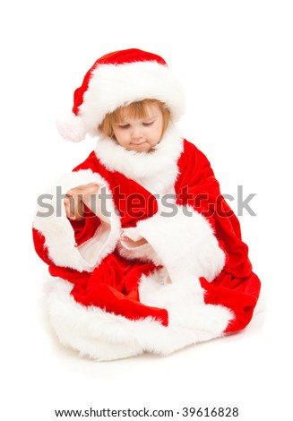 Baby Santa trying on a huge suit