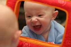 baby seeing self in mirror
